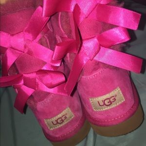 Pink uggs, bows in the back, used
